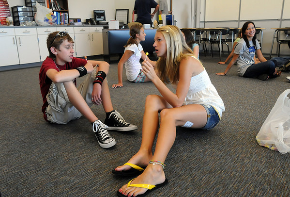 Freshman Adam Wolfson, left, and Alexa Briggs ask each other questions to learn about each other during Broomfield High School Freshman Orientation Day on Tuesday.<br /> <br /> August 18, 2009<br /> staff photo/David R. Jennings