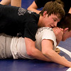 Courtland Hacker wrestles Nick Babcock at Broomfield High School wrestling practice on Monday. Photo by Matt Kelley/For the Enterprise.