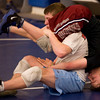 Courtland Hacker wrestles Jerry Huff during Broomfield High School wrestling practice on Monday. Photo by Matt Kelley/For the Enterprise.