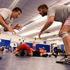 Nick Babcock and Matt Schmidt face off during Broomfield High School wrestling practice on Monday. Photo by Matt Kelley/For the Enterprise.
