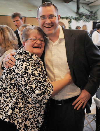 Judy Young gives boys basketball head coach Terrence Dunn a hug during the Broomfield High School Sports Gala on Friday at the Church Ranch Events Center. <br /> March 18, 2011<br />  staff photo/David R. Jennings
