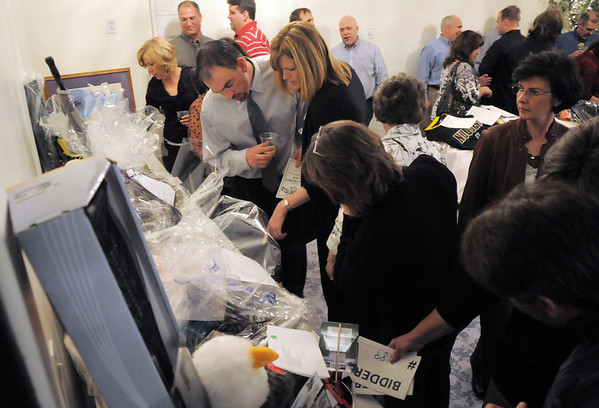 Attendees look at items at the auction tables during the Broomfield High School Sports Gala on Friday at the Church Ranch Events Center. <br /> March 18, 2011<br />  staff photo/David R. Jennings