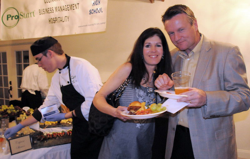 Lisa and Steve Zec pose at the Pro Start students food table at the Broomfield High School Sports Gala on Friday at the Church Ranch Events Center. <br /> March 18, 2011<br />  staff photo/David R. Jennings