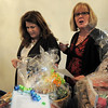 be0324gala06<br /> Nita Neelson, left, and Sheila Eakin look at the baskets in the austion area during the Broomfield High School Sports Gala on Friday at the Church Ranch Events Center. <br /> March 18, 2011<br />  staff photo/David R. Jennings