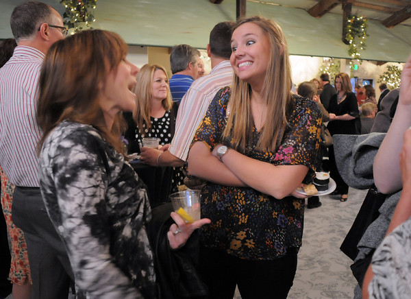 Kristin Waitkus, right, chats with Cathy Pazol during the Broomfield High School Sports Gala on Friday at the Church Ranch Events Center. <br /> March 18, 2011<br />  staff photo/David R. Jennings