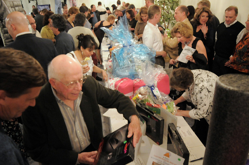 Attendees flock to the auction tables to bid on items at the Broomfield High School Sports Gala on Friday at the Church Ranch Events Center. <br /> March 18, 2011<br />  staff photo/David R. Jennings