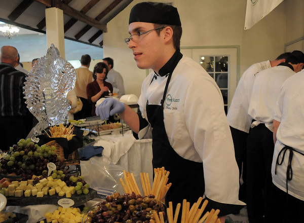 Shawn Sibley serves cheeses at the Pro Start area at the Broomfield High School Sports Gala on Friday at the Church Ranch Events Center. <br /> March 18, 2011<br />  staff photo/David R. Jennings