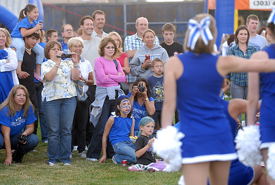 Fans watch the Broomfield poms perform a dance at the tailgate party before Friday's game against Monarch. September 16, 2011 staff photo/ David R. Jennings