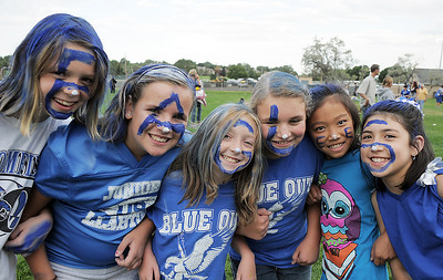 Ten year old fans Jenna Burgersser, left, Olivia Belton, Melanie Long, Meghan Roylance, Jana Compesi and Sarah Rosenblum painted their faces to spell out Eagles at the tailgate party before Friday's game against Monarch. September 16, 2011 staff photo/ David R. Jennings