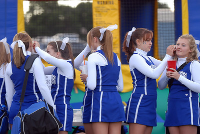 """The Broomfield High cheerleaders put """"B"""" temporary tattoos on their cheeks at the tailgate party before Friday's game against Monarch. September 16, 2011 staff photo/ David R. Jennings"""