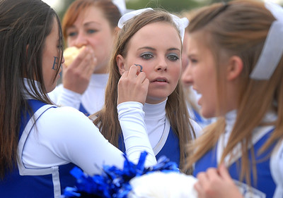 """Cheerleader Bailey Morton has a """"B"""" temporary tattoo put on her cheek at the tailgate party before Friday's game against Monarch. September 16, 2011 staff photo/ David R. Jennings"""