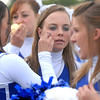 """Cheerleader Bailey Morton has a """"B"""" temporary tattoo put on her cheek at the tailgate party before Friday's game against Monarch.<br /> September 16, 2011<br /> staff photo/ David R. Jennings"""