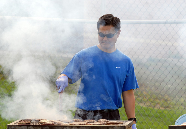 Dan Fukushima cooks hamburgers at the tailgate party before Friday's game against Monarch.<br /> September 16, 2011<br /> staff photo/ David R. Jennings