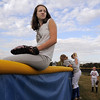 Michaela Peters, 14, sits on the softball field fence waiting for fly balls during the homerun hitting competition at the tailgate party before Friday's game against Monarch.<br /> September 16, 2011<br /> staff photo/ David R. Jennings