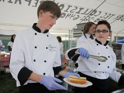 ProStart students Nick Welsh and Lauren Kennedy serve participants  at the tailgate party before Friday's game against Monarch. September 16, 2011 staff photo/ David R. Jennings