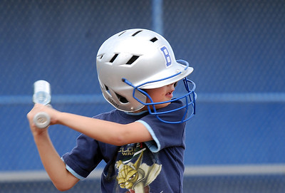 Reilly Brask-Bratsher, 7, gets ready to take a swing during the home run hitting contest at the tailgate party before Friday's game against Monarch. September 16, 2011 staff photo/ David R. Jennings