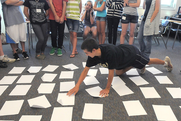 Freshman Alex Hohensee straightens out papers representing rocks turtles and water for an exercise for the Blue Crew freshman orientation at Broomfield High School on Monday.<br /> <br /> August 15, 2011<br /> staff photo/ David R. Jennings