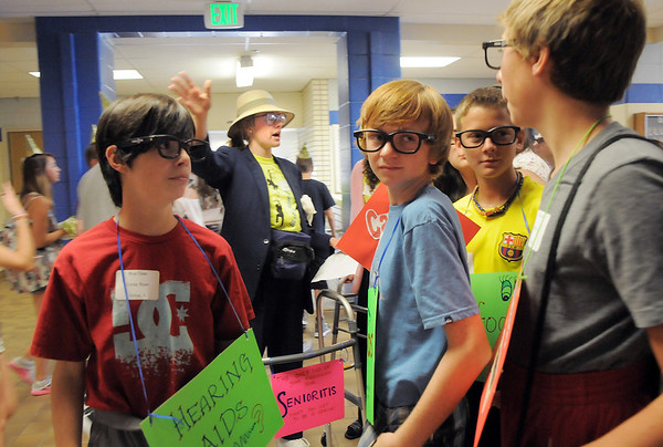 Blue Crew leader Kathryn Middel-Katzenmeyer, center, gives shortcut pointers to her group, dressed in costumes,  on a tour of the school during freshman orientation at Broomfield High School on Monday.<br /> <br /> August 15, 2011<br /> staff photo/ David R. Jennings
