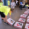 Blue Crew leader Nate Disser helps organize the 100 pizza boxes for the freshman during orientation at Broomfield High School on Monday.<br /> <br /> August 15, 2011<br /> staff photo/ David R. Jennings