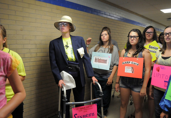 "Blue Crew member Kathryn Middel-Katzenmeyer, left, leads her group, dressed in costumes, on a tour of the school during freshman orientation at Broomfield High School on Monday.  Middel-Katzenmeyer's group called ""Senioritis"" won the costume contest.<br /> <br /> August 15, 2011<br /> staff photo/ David R. Jennings"