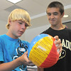 Freshman Colin Peterson, left, reads and answers a question written on a beach ball with classmate Alex Hohensee during the Blue Crew freshman orientation at Broomfield High School on Monday.<br /> <br /> August 15, 2011<br /> staff photo/ David R. Jennings