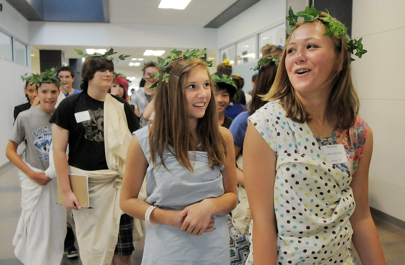 Gabby Licht, left, and Nicole Leher dressed in toga costumes tour the school led by Blue Crew members during freshman orientation at Broomfield High School on Monday.<br /> <br /> August 15, 2011<br /> staff photo/ David R. Jennings