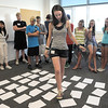 Freshman Michaela Peters tries to walk on the correct papers representing rocks turtles and water for an exercise for the Blue Crew freshman orientation at Broomfield High School on Monday.<br /> <br /> August 15, 2011<br /> staff photo/ David R. Jennings