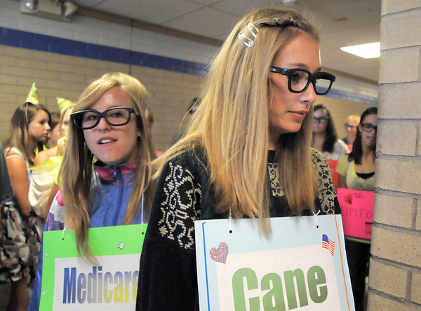 Freshmen Alicia Marquez, left, and Mindy Jones follow their Blue Crew leader on a tour fo the school dressed in costumes during orientation at Broomfield High School on Monday.<br /> <br /> August 15, 2011<br /> staff photo/ David R. Jennings