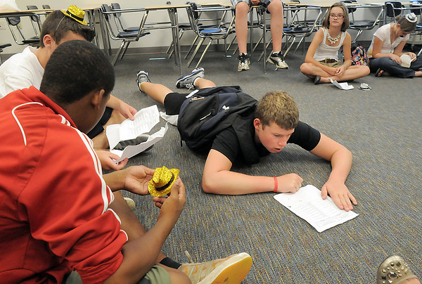 Freshman Blake Whitsell, right, lays on the floor trying to figure out his schedule during the Blue Crew freshman orientation at Broomfield High School on Monday.<br /> <br /> August 15, 2011<br /> staff photo/ David R. Jennings