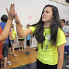 Blue Crew leader Katalena Laufasa-Duncan gives high fives to freshman in her group during freshman orientation at Broomfield High School on Monday.<br /> <br /> August 15, 2011<br /> staff photo/ David R. Jennings