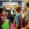 Blue Crew leader Kathryn Middel-Katzenmeyer, center, gives  pointers to her group, dressed in costumes,  on a tour of the school during freshman orientation at Broomfield High School on Monday.<br /> <br /> August 15, 2011<br /> staff photo/ David R. Jennings