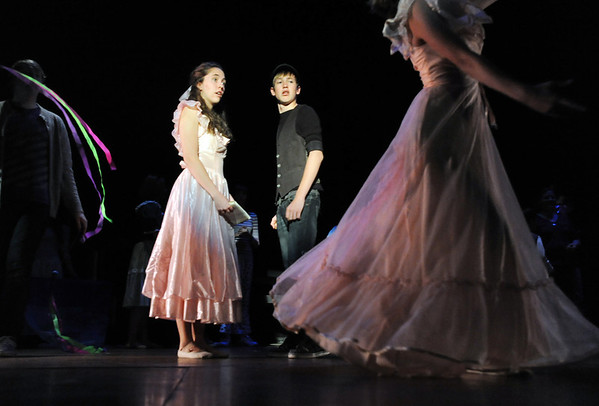Rachel Kois, left, and Liam Broadhurst watch a dancer go by in the opening number during rehearsal for Broomfield High's production of Carousel on Monday.<br /> <br /> <br /> April 9, 2012 <br /> staff photo/ David R. Jennings