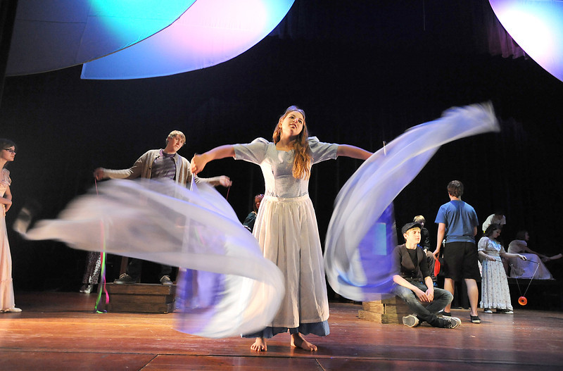 Bridget Admire waves flags for the opening number of Broomfield High's production of Carousel during rehearsal for on Monday.<br /> <br /> <br /> April 9, 2012 <br /> staff photo/ David R. Jennings
