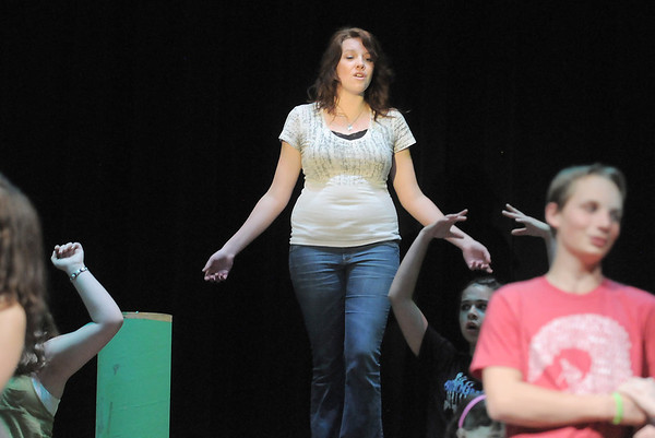 Alisa Tripp, playing Nettie Fowler, sings during rehearsal for Broomfield High's production of Carousel on Monday.<br /> <br /> <br /> April 9, 2012 <br /> staff photo/ David R. Jennings