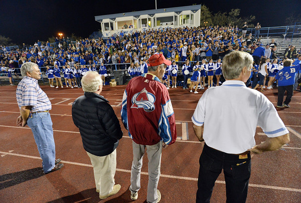Members of the first Broomfield High football team are recognized at halftime during Friday's Broomfield High homecoming game at Elizabeth Kennedy Stadium.<br /> September 21, 2012<br /> staff photo/ David R. Jennings