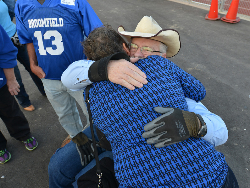 Rick Graham is hugged by Jema Gandy Mendelsberg class of 1966 during Friday's Broomfield High homecoming game at Elizabeth Kennedy Stadium.<br /> September 21, 2012<br /> staff photo/ David R. Jennings