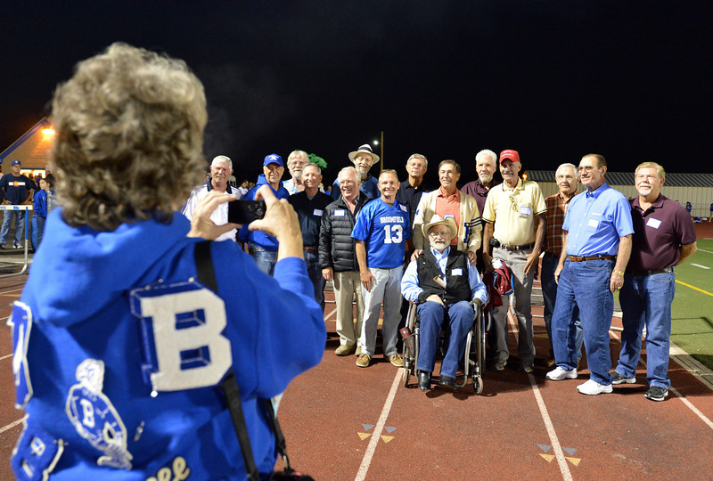 Members of the first football team of Broomfield High have their picture taken by Renee Kozisek during Friday's Broomfield High homecoming game at Elizabeth Kennedy Stadium.<br /> September 21, 2012<br /> staff photo/ David R. Jennings