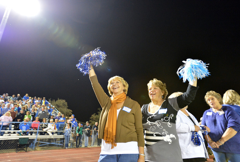 Sisters Darline Peak Head, class of '68, left, and Judy Peak Fitzsimmons, class of '67, members of the original Broomfield High pom squad cheer during Friday's Broomfield High homecoming game at Elizabeth Kennedy Stadium.<br /> September 21, 2012<br /> staff photo/ David R. Jennings