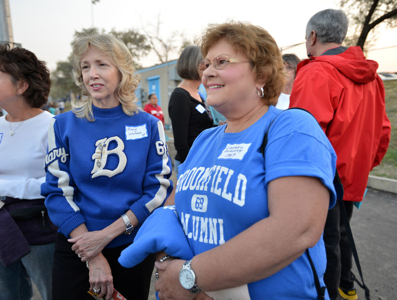 Class of 1969 members Mary Whitman,left, and Laurel Shimpfky  reminisce before  Friday's Broomfield High homecoming game at Elizabeth Kennedy Stadium.<br /> September 21, 2012<br /> staff photo/ David R. Jennings