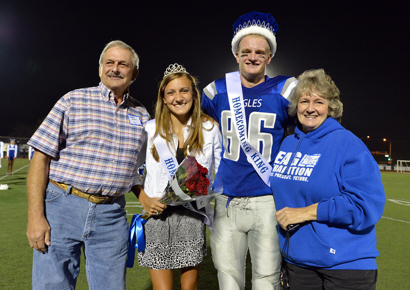 Jerre West, class of '62, left, the first homecoming king of Broomfield High  and Renee Kozisek, right , the second homecoming queen of the school, pose with Katie Croell and Dan Perse, the current king and queen during Friday's Broomfield High homecoming game at Elizabeth Kennedy Stadium.<br /> September 21, 2012<br /> staff photo/ David R. Jennings