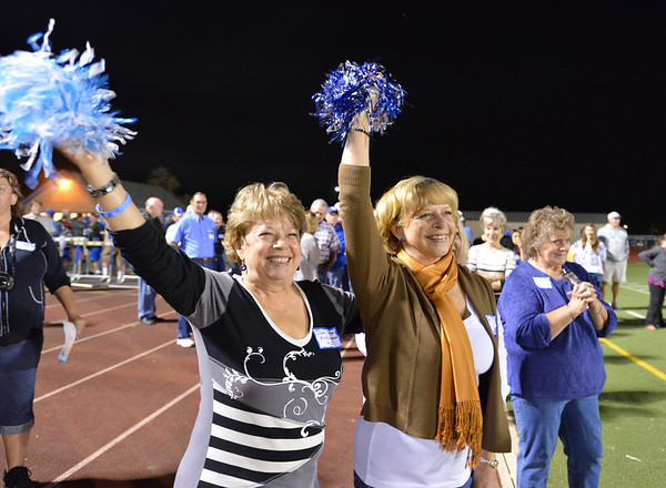 Sisters, Judy Peak Fitzsimmons, class of '67, left, and Darline Peak Head, class of '68, members of the original Broomfield High pom squad cheer during Friday's Broomfield High homecoming game at Elizabeth Kennedy Stadium.<br /> September 21, 2012<br /> staff photo/ David R. Jennings