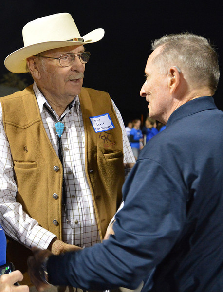 Dick Lewis, left, the first principal of Broomfield High greets Doug Holden class of 1965 during Friday's Broomfield High homecoming game at Elizabeth Kennedy Stadium.<br /> September 21, 2012<br /> staff photo/ David R. Jennings