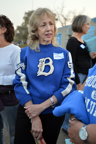 Mary Whitman class of 1969 wore her cheerleading sweater to the 50th reunion celebration  during Friday's Broomfield High homecoming game at Elizabeth Kennedy Stadium.<br /> September 21, 2012<br /> staff photo/ David R. Jennings