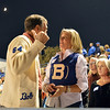 Classmates of 1964 Bob Searls and Kathi Stork  chat in the stands during Friday's Broomfield High homecoming game at Elizabeth Kennedy Stadium.<br /> September 21, 2012<br /> staff photo/ David R. Jennings