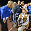 Broomfield High principal Ginger Ramsey, left, chats with the first principal of the school Dick Lewis during Friday's Broomfield High homecoming game at Elizabeth Kennedy Stadium.<br /> September 21, 2012<br /> staff photo/ David R. Jennings