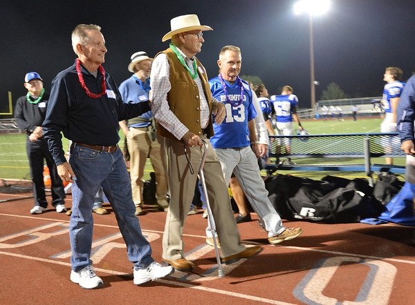 Broomfield High's first principal Dick Lewis is escorted by Doug Holden and Lee Holden for the half-time ceremony recognizing the 50th reunion of the first classes of the school at Friday's Broomfield High homecoming game at Elizabeth Kennedy Stadium.<br /> September 21, 2012<br /> staff photo/ David R. Jennings