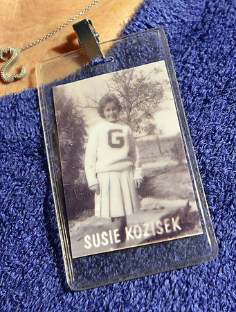 Susie Kozisek wears a photo of herself in her pom squad uniform  during Friday's Broomfield High homecoming game at Elizabeth Kennedy Stadium.<br /> September 21, 2012<br /> staff photo/ David R. Jennings