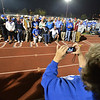 Renee Kozisek takes pictures of the first football team of Broomfield High  during halftime at Friday's Broomfield High homecoming game at Elizabeth Kennedy Stadium.<br /> September 21, 2012<br /> staff photo/ David R. Jennings
