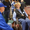 Paul Shepherd, left, and Rick Graham reminisce about  high school life in the 1960's during Friday's Broomfield High homecoming game at Elizabeth Kennedy Stadium.<br /> September 21, 2012<br /> staff photo/ David R. Jennings