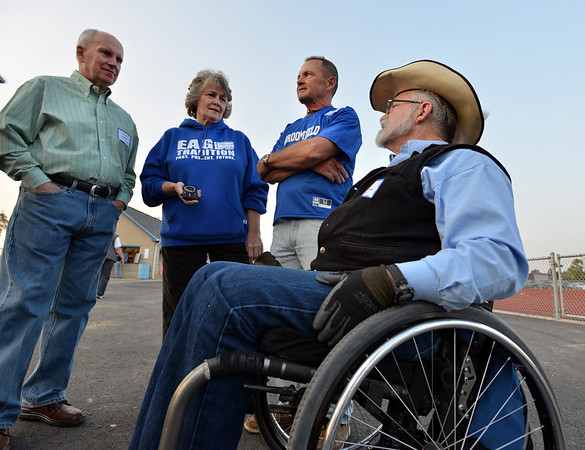 Classmates Steve Stork, left, Renee Kozisek,  Lee Holden and Rick Graham  reminisce about being the first students of Broomfield Hfigh during Friday's Broomfield High homecoming game at Elizabeth Kennedy Stadium.<br /> September 21, 2012<br /> staff photo/ David R. Jennings